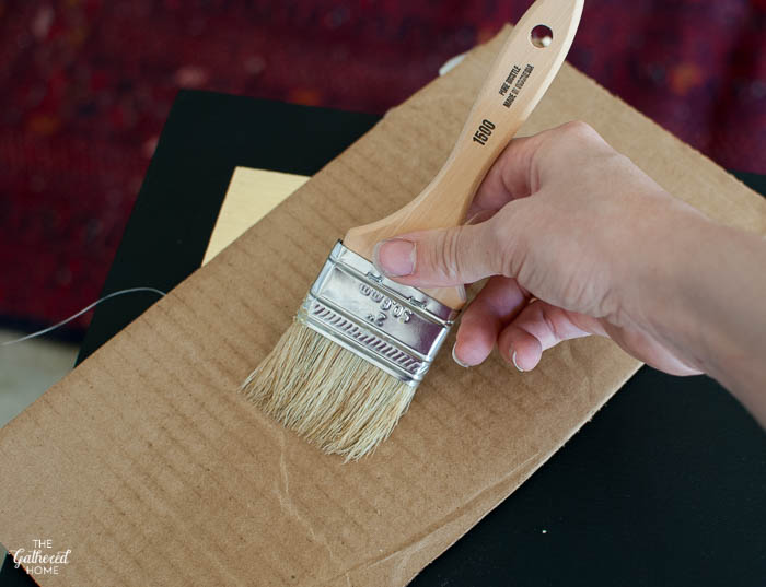 Remove excess wax from your brush by swiping it across a piece of cardboard several times.