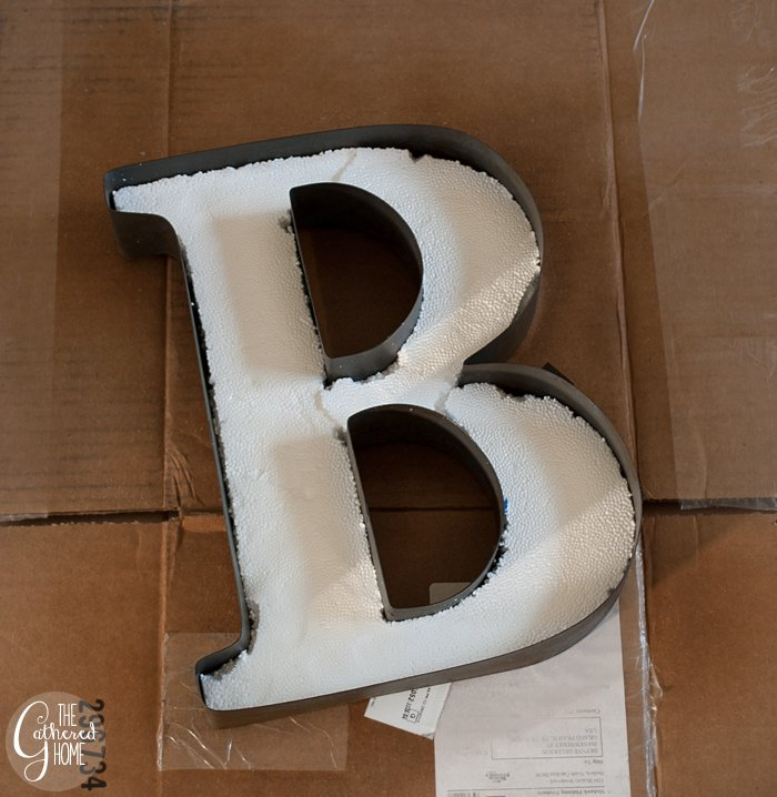 Fill the shape of the letter with foam to create a base for the moss.