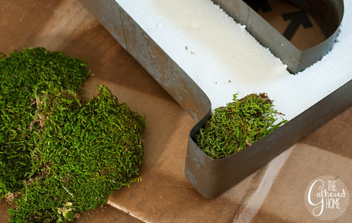 Glue the sheet moss to fill in the rusted metal letter