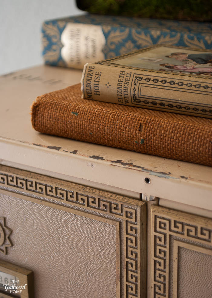 How to decorate with vintage and antique books - book covers can add fantastic texture to any vignette!