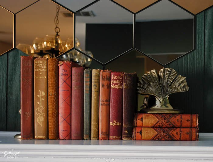 Display books with similar hues for a perfect seasonal mantel decoration. Don't let your favorite literary treasures languish on the shelves - when you're not enjoying reading them, incorporate your beautiful books into your decorating! Plus, tips on where to find the best vintage and antique books.