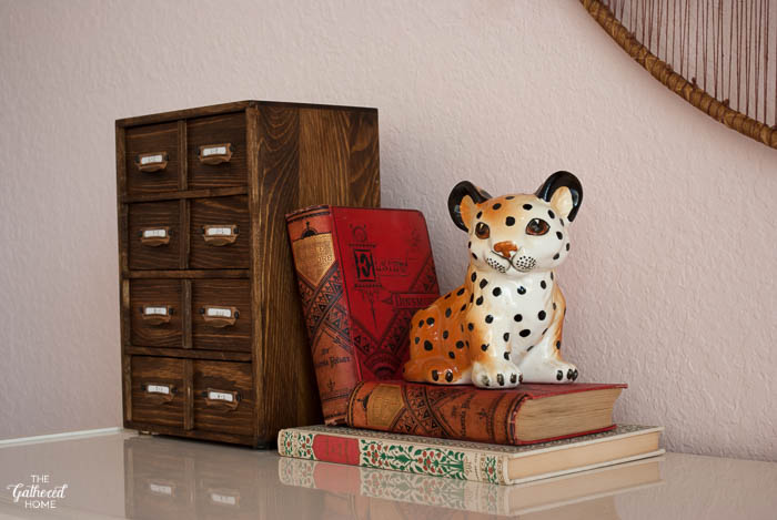 Use vintage and antique books to create a pedestal to display smaller decorative objects.