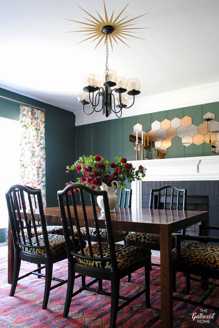 The Gathered Home dining room with vintage burl dining table and black Chinese Chippendale chairs
