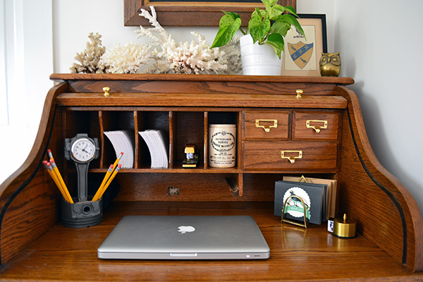 Desk styling with brass accessories via Angie's Roost