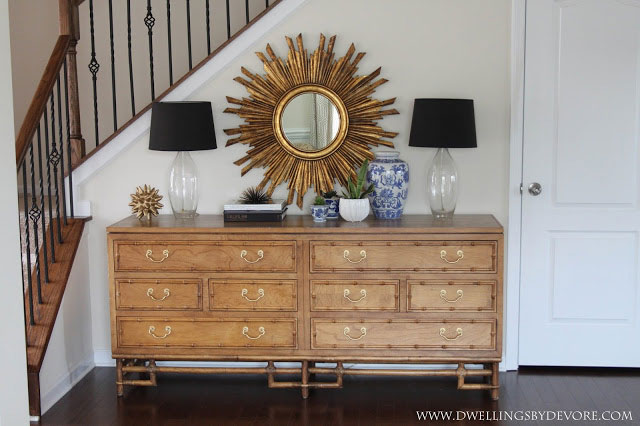 Faux bamboo dresser in the entryway via Dwellings by Devore
