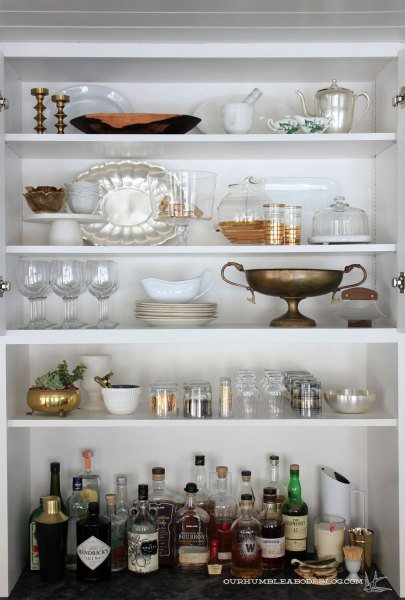 thrifted-serving-pieces-in-hutch via Our Humble Abode