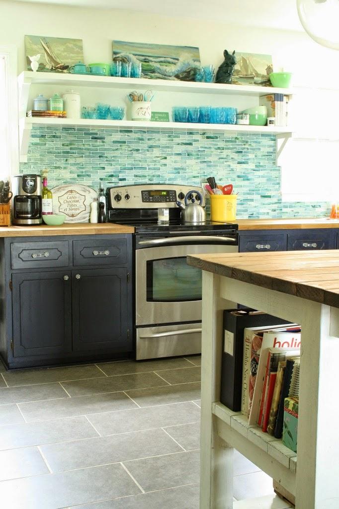 vintage seascapes in the kitchen via Primitive & Proper
