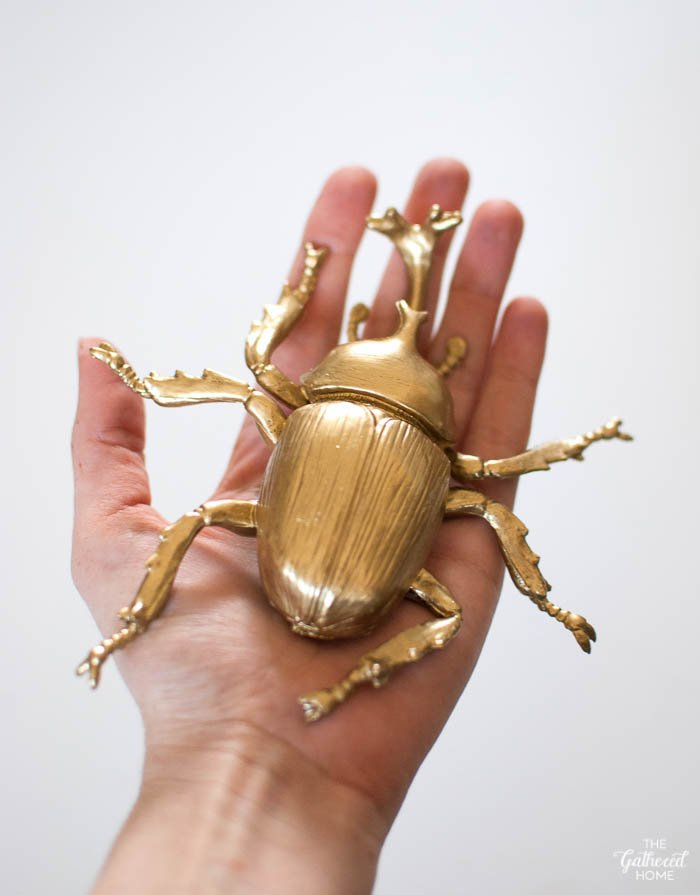 gilded plastic beetle with liquid gold leaf
