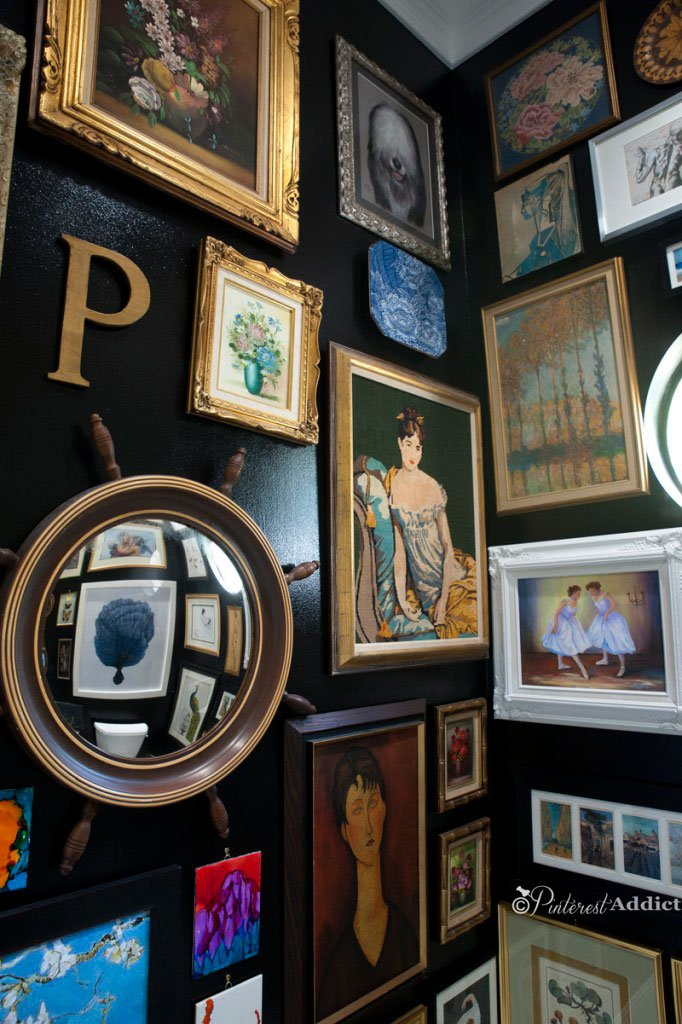 Bathroom gallery wall with needlepoint art via A Pinterest Addict