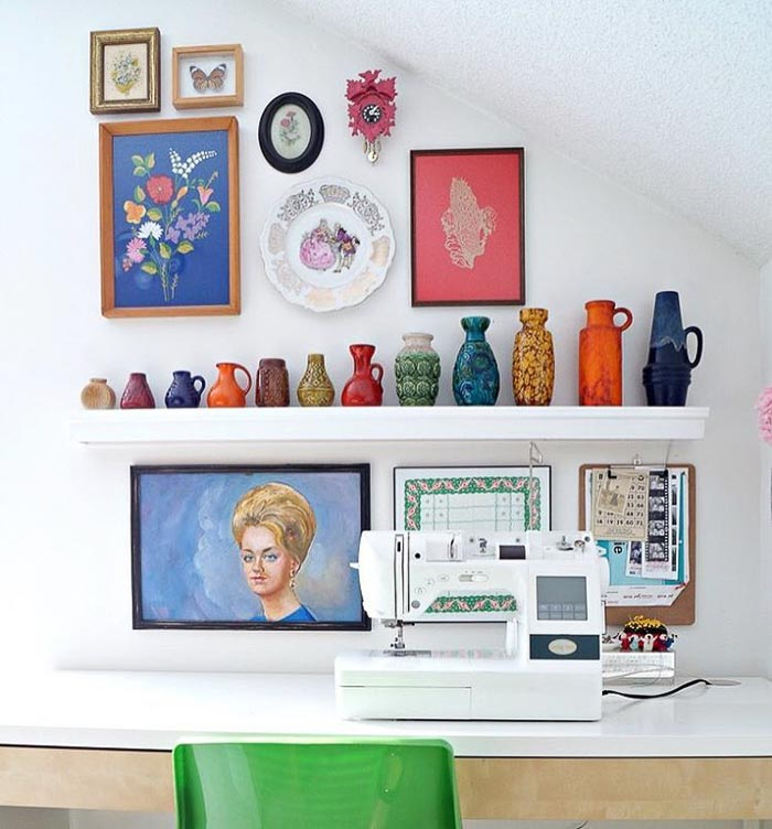 Studio sewing room gallery wall with vintage embroidery via Maggie Overby Studios