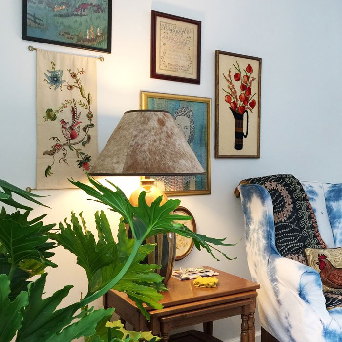 Vintage embroidery gallery wall via At Home On The Bay