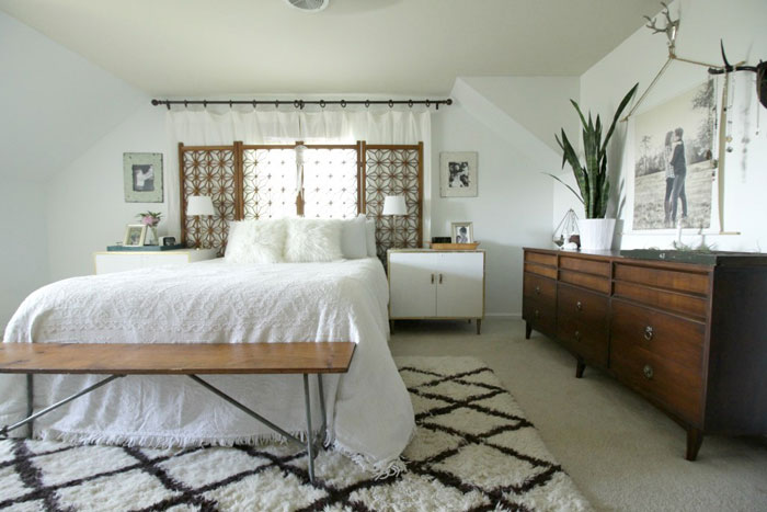 Master bedroom with vintage screen headboard and mid century dresser via Primitive and Proper