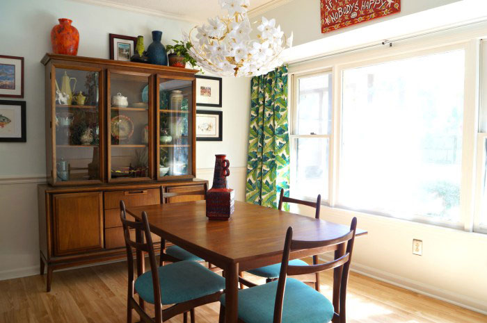 Mid Century Modern dining room table and chairs and china cabinet via Maggie Overby Studios