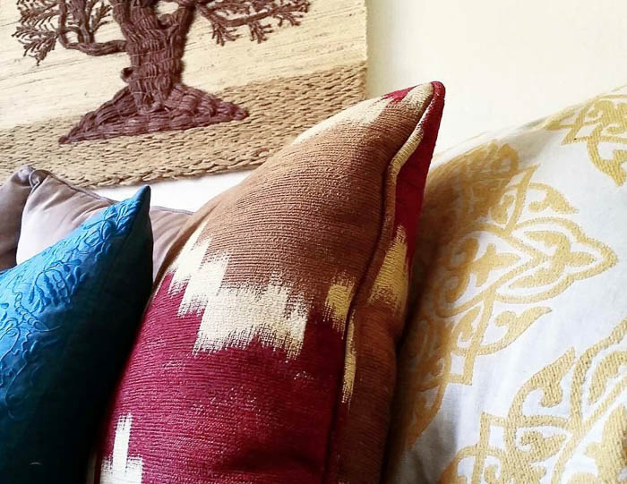 Thrift Score Thursda feature wine and tan pillows via ourcozyhome