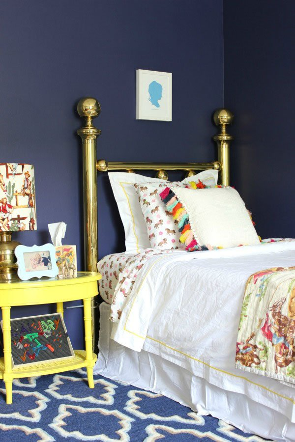 Vintage brass twin bed and yellow painted night stand via Rain On A Tin Roof