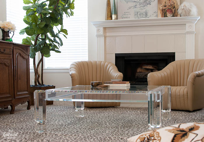 "Vintage lucite coffee table + 1980's leather channel-back chairs. Just enough ""Scarface"" to be totally awesome!"