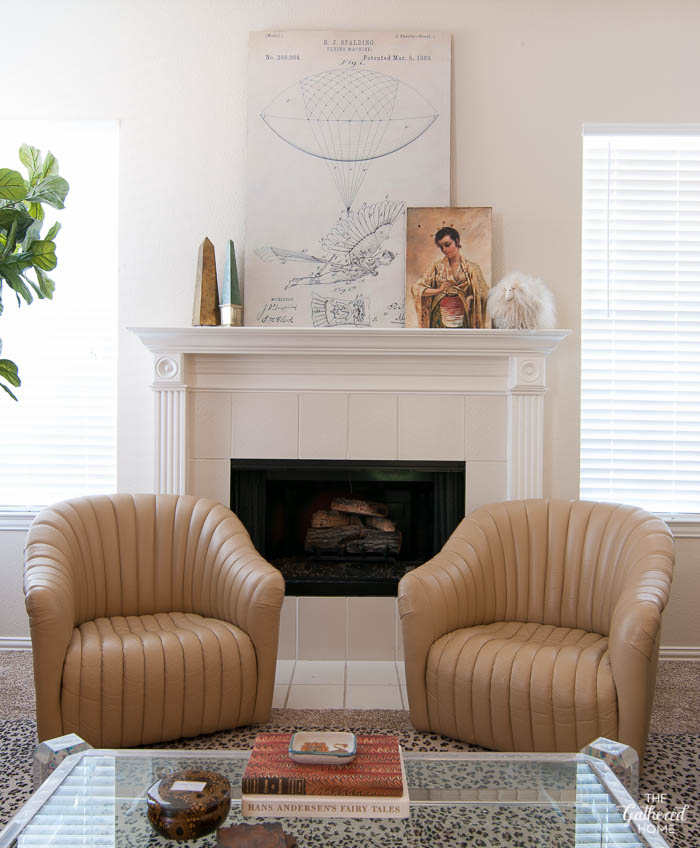 Beige on beige. Loving these 1980's leather channel-back chairs with this eclectic mantel!