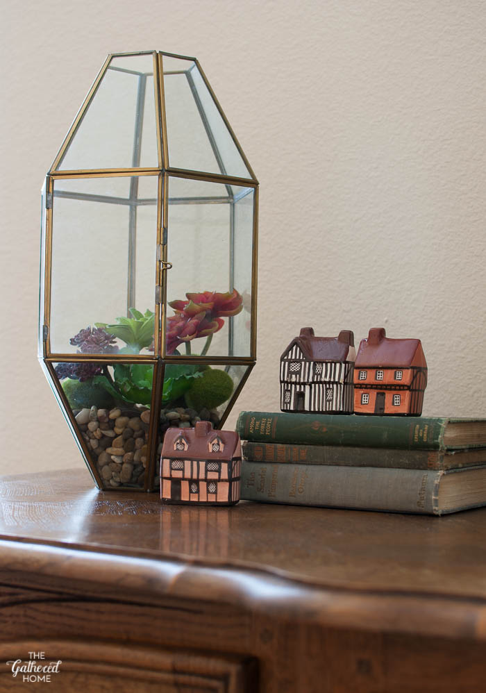 Brass and glass light fixture turned terrarium + a small collection of Mudlen End Cottages.