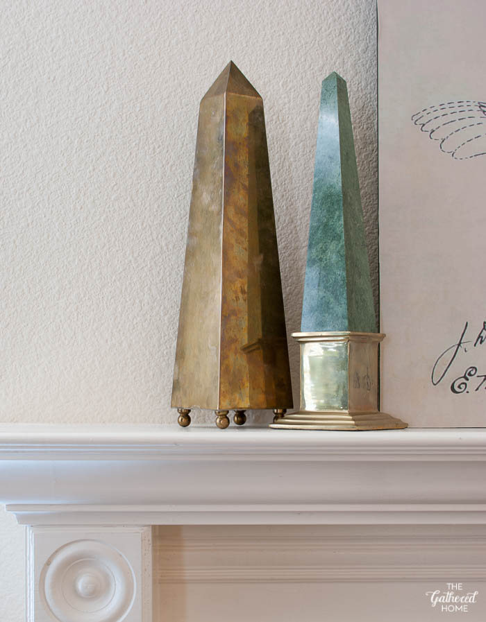 living room mantel brass obelisk and brass and marble obelisk