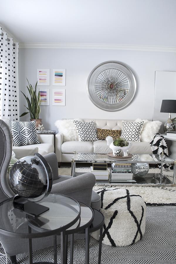 Black acrylic globe in the living room, via Cuckoo4Design