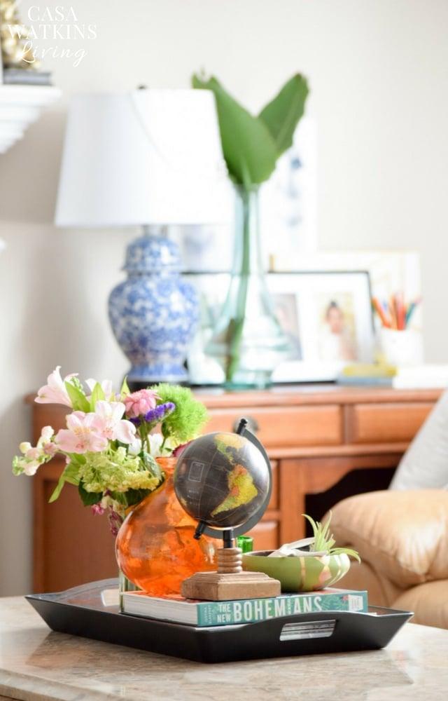 Mini globe in a coffee table vignette via Casa Watkins Living