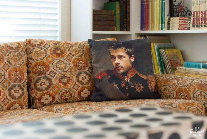 the-gathered-home-library-brad-pitt-pillow-on-thayer-coggin-sofa