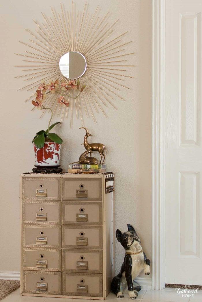 "Entryway: DIY sunburst mirror, vintage post office box, Fitz & Floyd ""temple dragon"" planter"