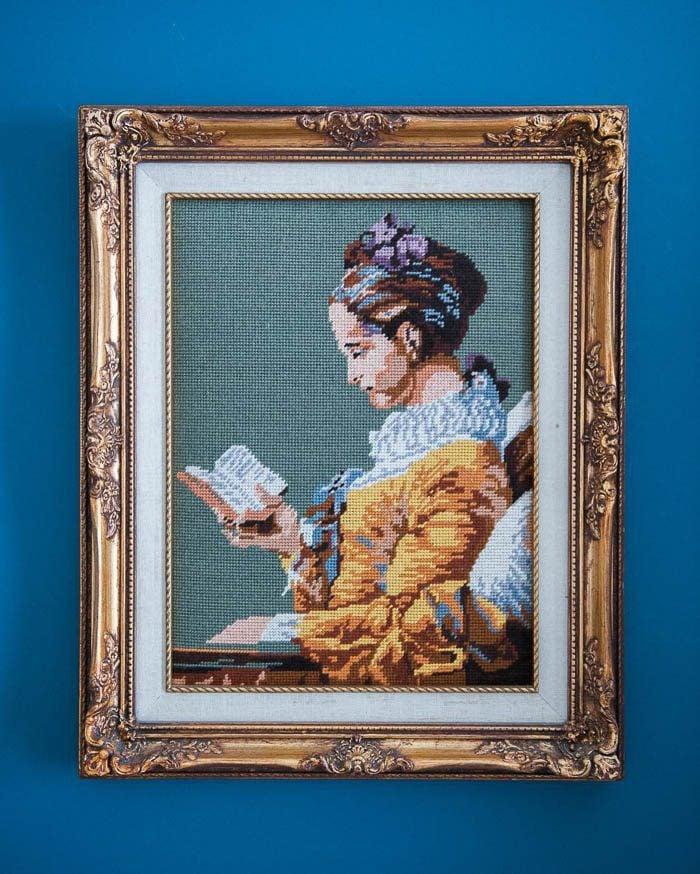 thrift-score-thursday-feature-woman-reading-needlepoint-via-melissabrandman