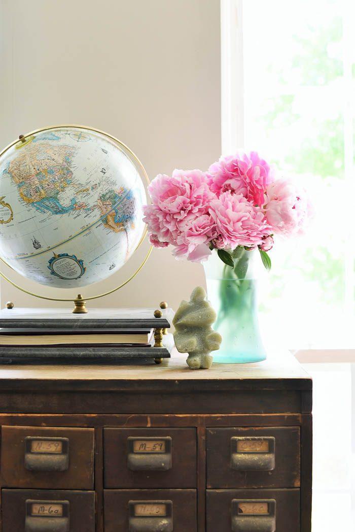 Vintage globe vignette on top of an antique card catalog, via Curiosities Home