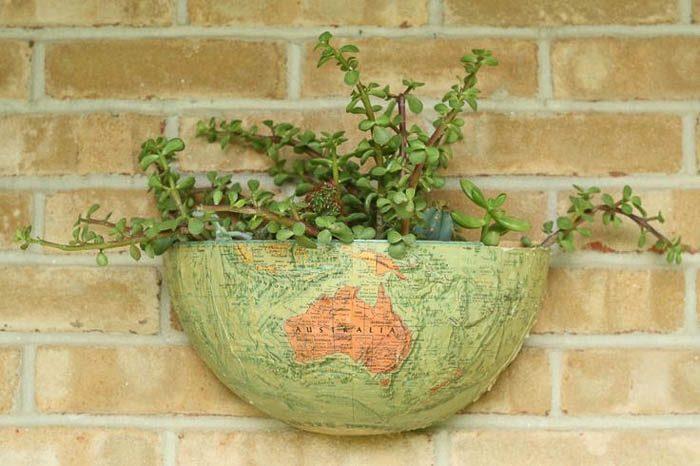 Vintage globe turned wall pocket succulent planter via Cassie Bustamante