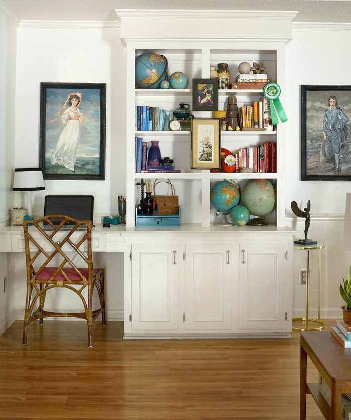 Vintage globe collection living room bookcase styling, via Maggie Overby Studios