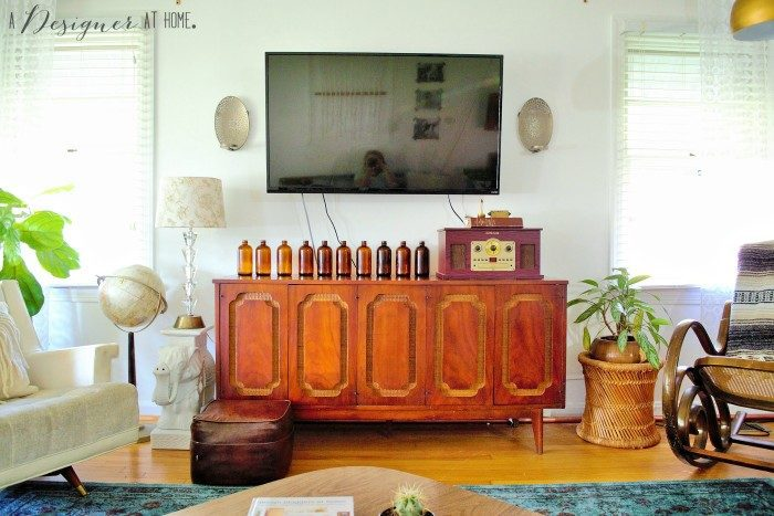 Vintage standing globe in the living room, via A Designer At Home