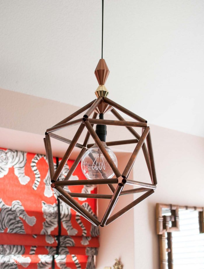 DIY copper pipe geometric pendant light with pink kitchen walls
