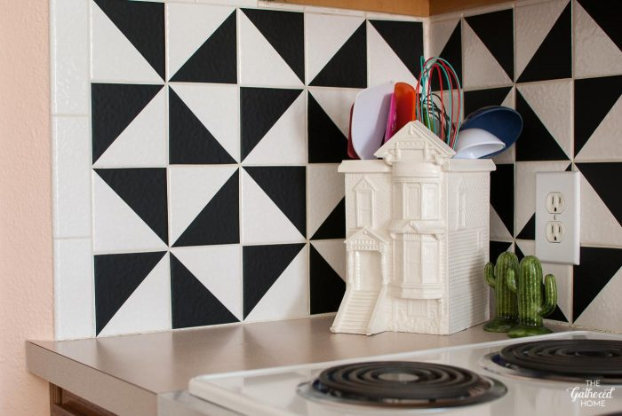 Detail of DIY vinyl triangle kitchen-backsplash