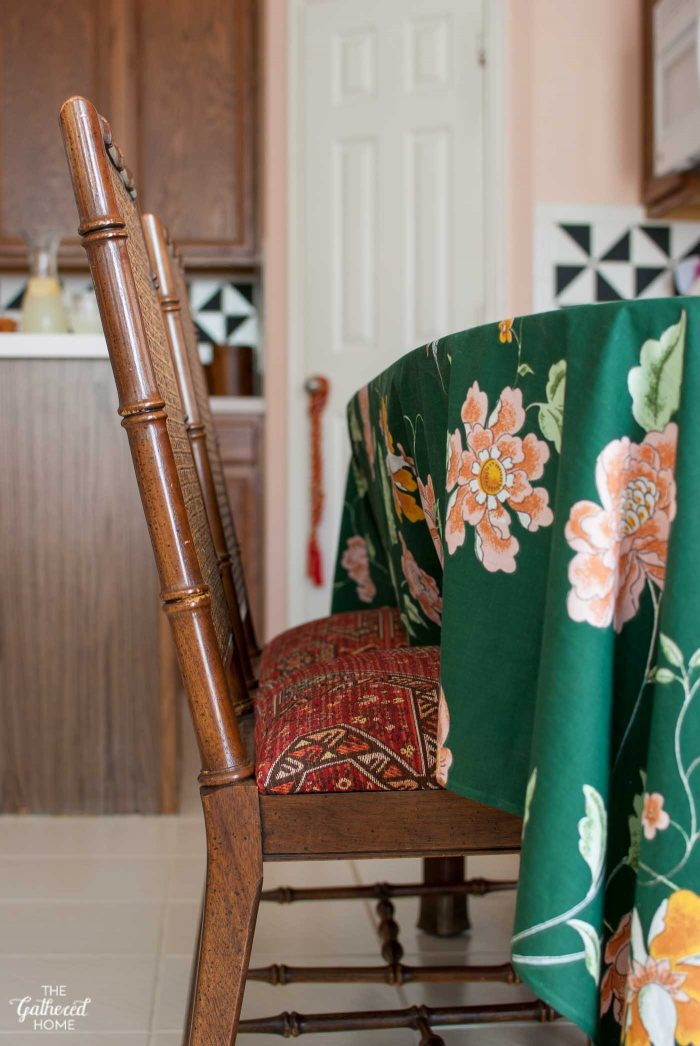Vintage faux bamboo dining chairs reupholstered with persian rug chenille fabric