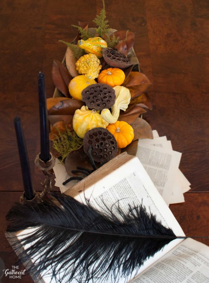 This richly colorful and textural Halloween centerpiece holds just a hint of the macabre... Do you see it?