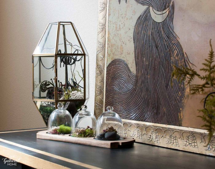 This collection of terrariums on the dining room sideboard hold a sinister secret... You simply must take a closer look!