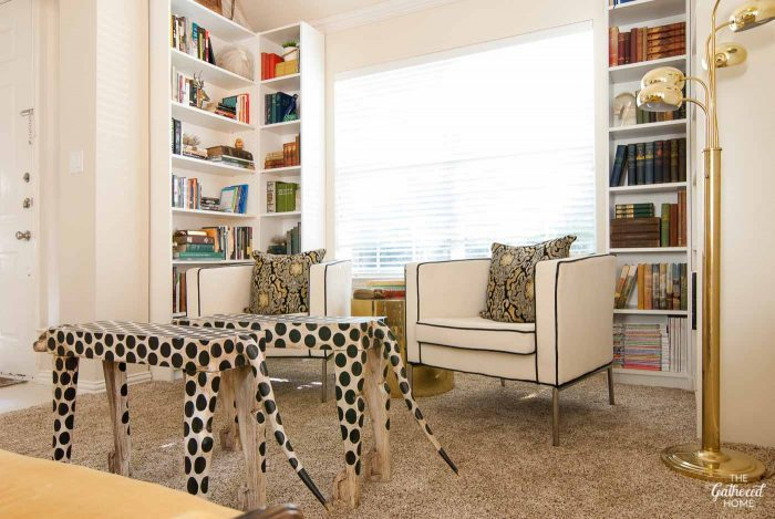library-nook-with-bookshelves-and-leopard-tables
