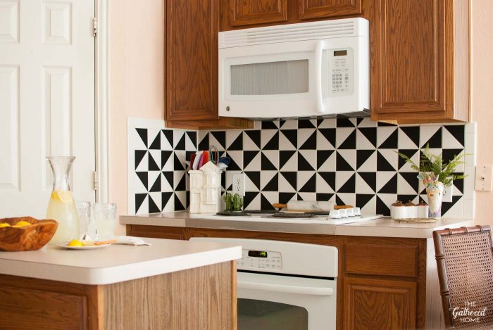 This boring tile kitchen backsplash got an extreme makeover using VINYL! So easy and so affordable!