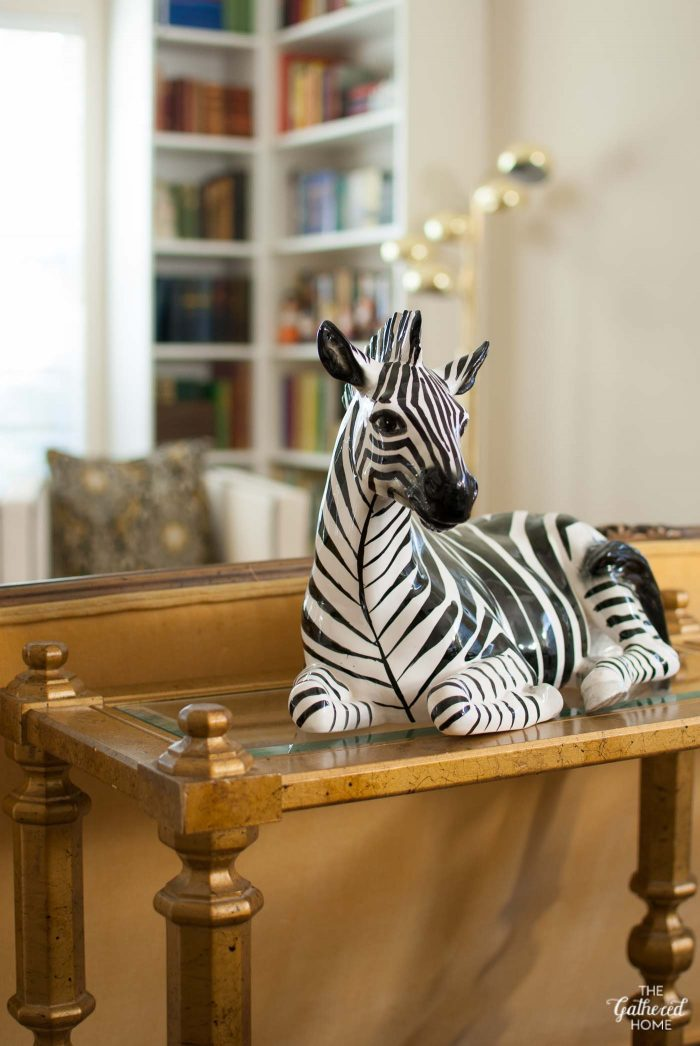 vintage-ceramiz-zebra-statue-on-gold-console-table