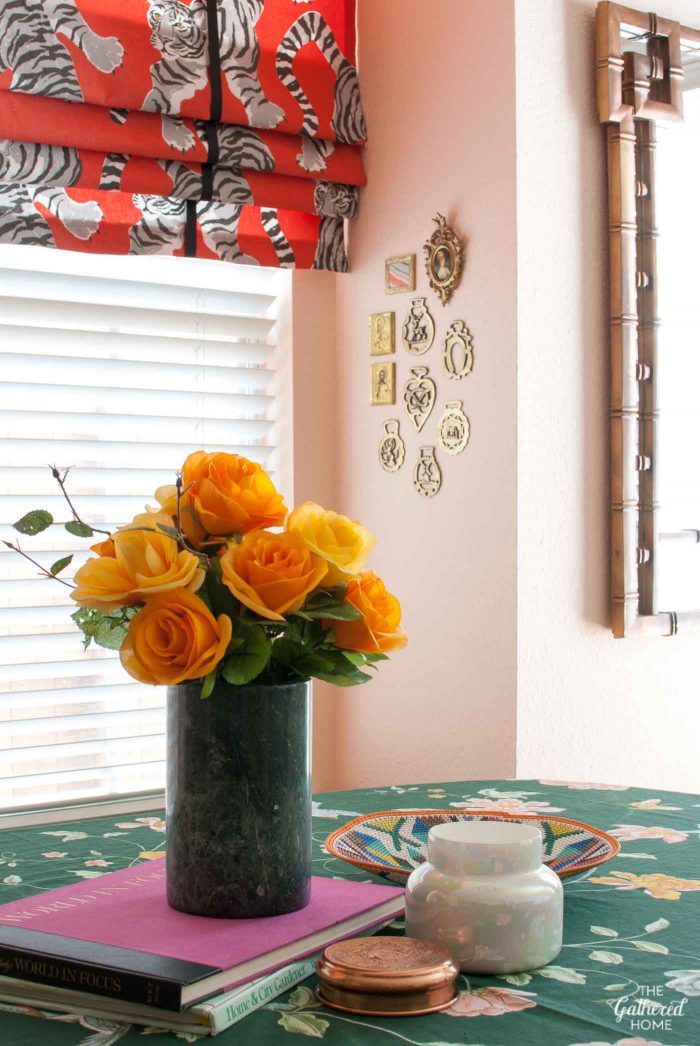 Wild & whimsical pink kitchen makeover - on the table: marble vase with yellow roses