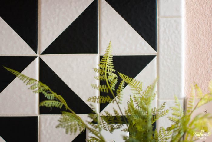 Closeup detail of the DIY black vinyl triangle tile backsplash - a super affordable and easy DIY project!