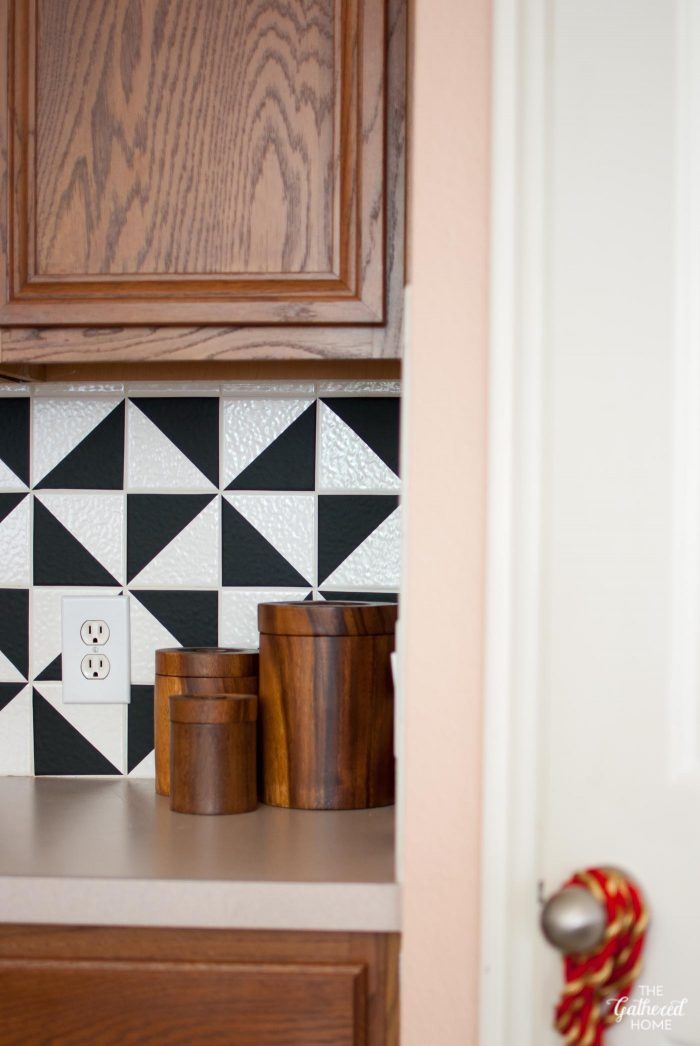 Detail of DIY black and white patterned backsplash