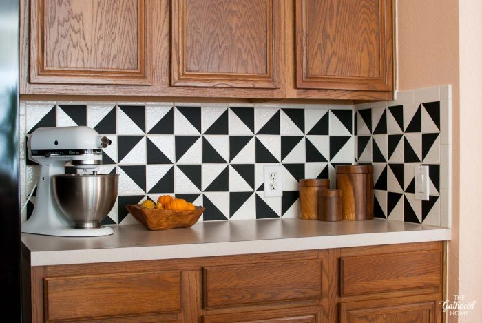 Did you know you could completely revamp your kitchen's existing tile backsplash using VINYL? This DIY is super easy and affordable!