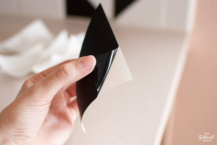 peel-vinyl-triangle-off-of-paper-backing