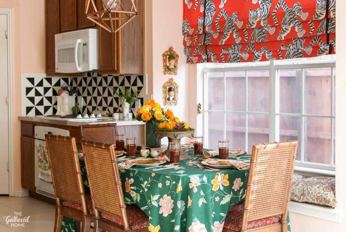 """Granny Chic"" Thanksgiving table setting with layers of florals and vintage dishware"