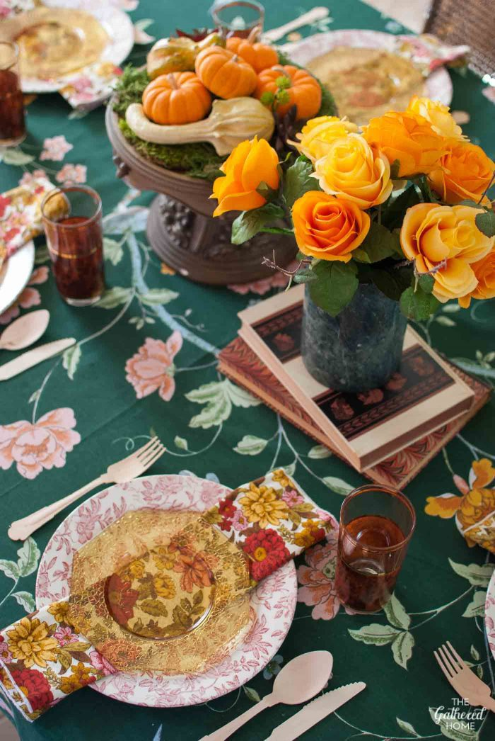"Shades of amber and bold floral patterns come together to make this vibrant ""Granny Chic"" Thanksgiving table setting, full of vintage treasures!"