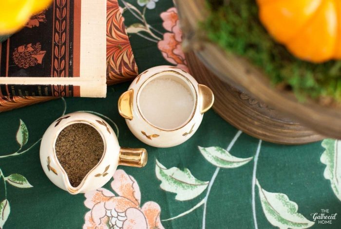 A vintage gold-adorned petite sugar and creamer set hold salt and pepper on this Thanksgiving table
