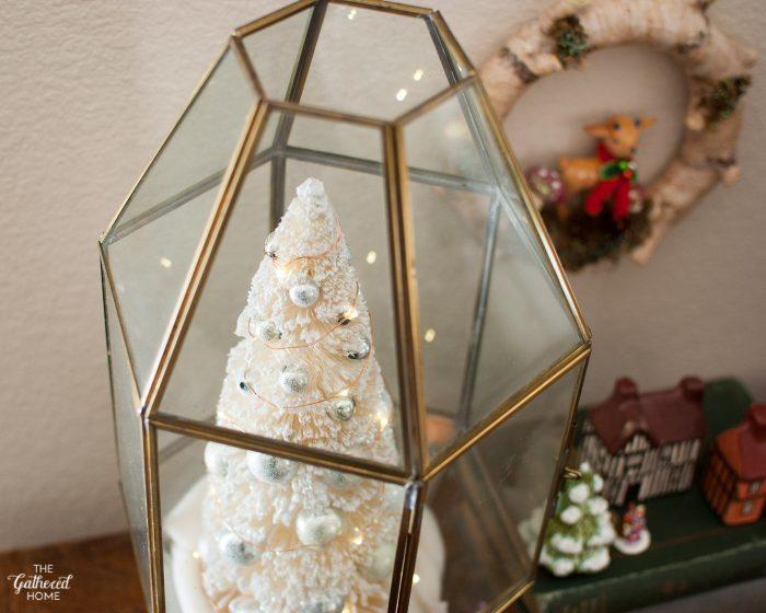 Glass and brass light fixture turned Christmas terrarium!