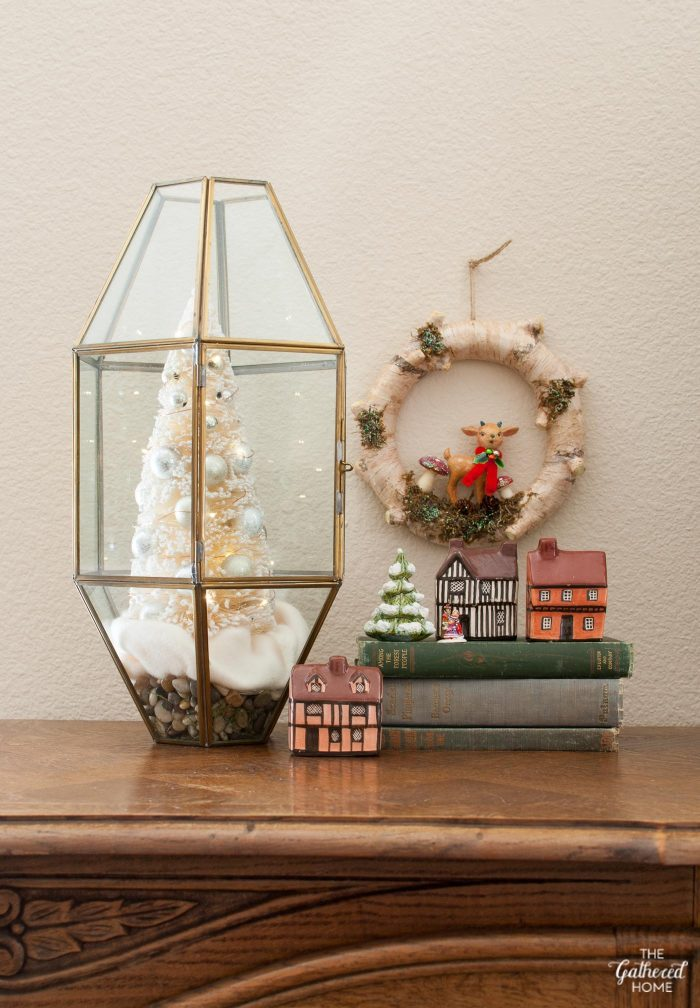 This terrarium is made out of a thrifted brass and glass light fixture! It's filled with fake snow and a bottle brush Christmas tree, lighted with mini LED fairy lights!